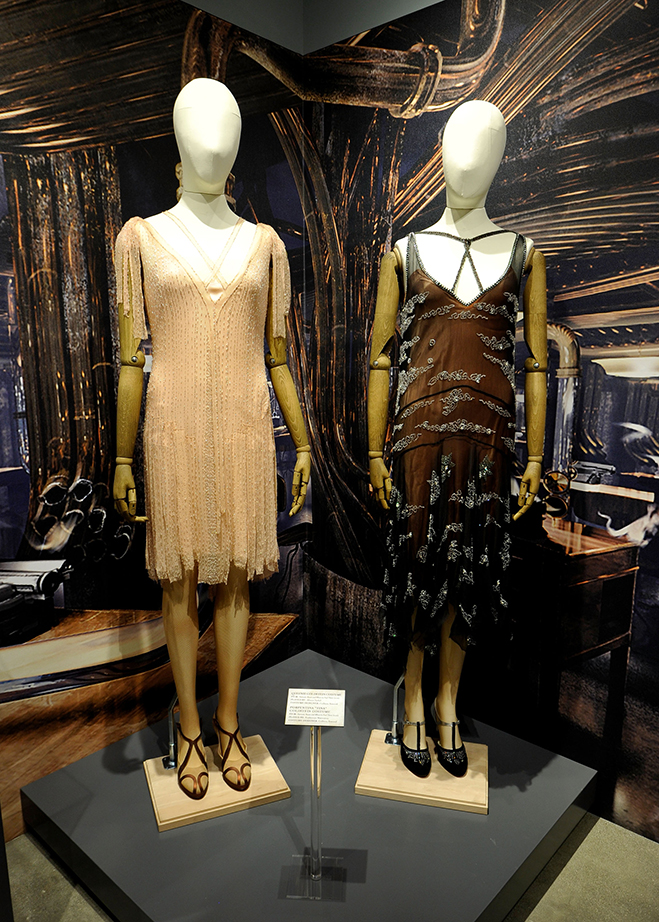 character costumes like queenie's and tina's from fantastic beasts are on display at the new warner bros. studio tour hollywood exhibit