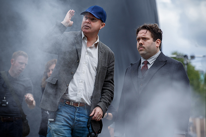 Director David Yates on the Fantastic Beasts set with actor Dan Fogler as Jacob Kowalski.