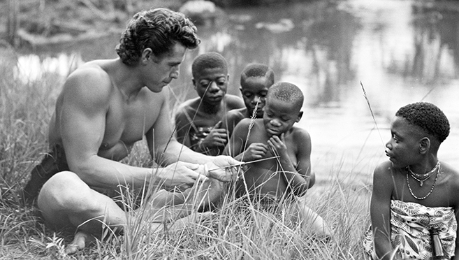 "gordon scott as tarzan with young extras on the set of 1957's ""tarzan and the lost safari"""