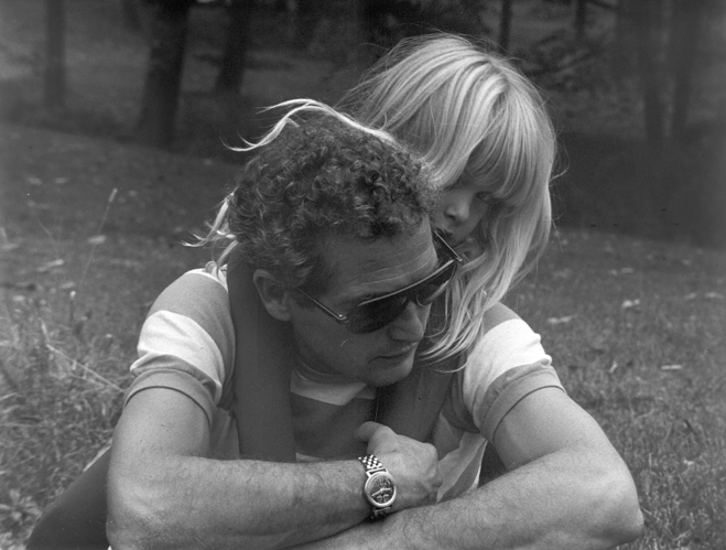 Medium BTS shot of director Paul Newman with daughter Nell Potts as Rachel as a child on back.