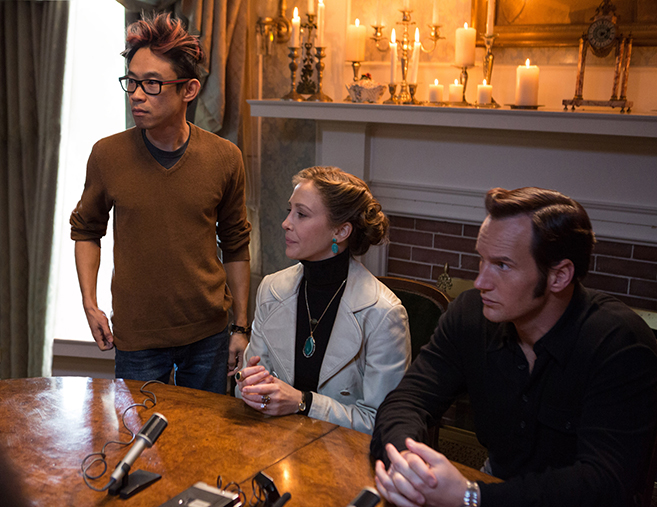 director james wan on the set of the conjuring 2 with stars vera farmiga and patrick wilson