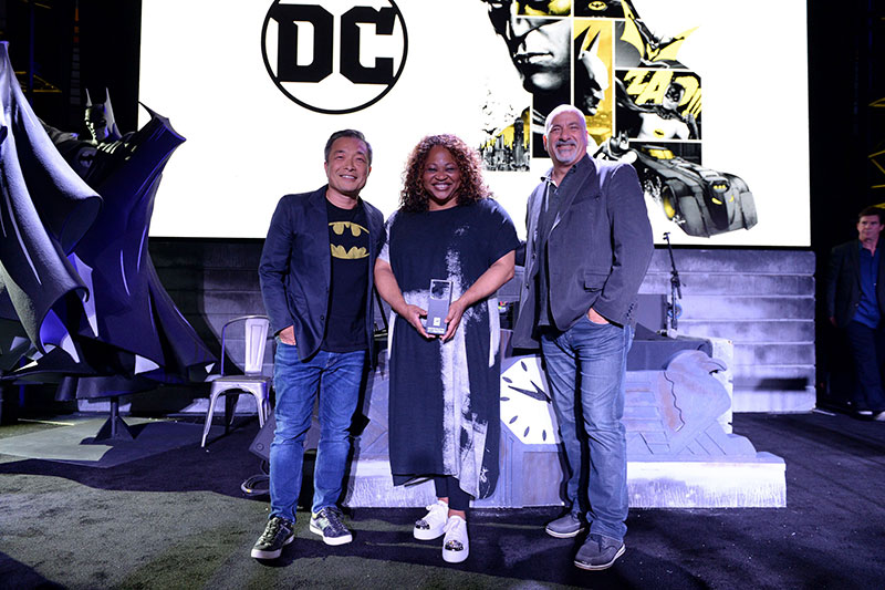 DC's Jim Lee, Pam Lifford and Dan DiDio accept the award inducting Batman into the Comic Con Museum Hall of Fame.