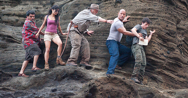 Luis Guzman, Vanessa Hudgens, Michael Caine, Dwayne Johnson and Josh Hutcherson traverse a dangerous mountain path in Journey 2: The Mysterious Island