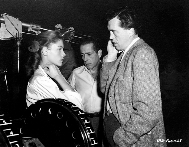 Behind-the-scenes with Bacall, Bogart, and director John Huston.