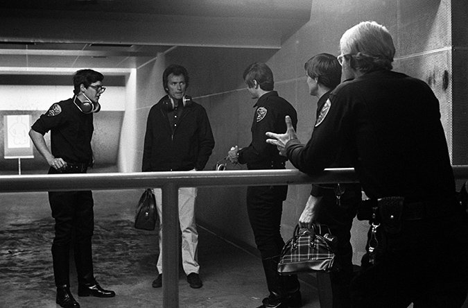 Clint Eastwood as Harry Callahan is conversing with some of the rogue cops, played by Tim Matheson, Robert Urich, Kip Niven, and David Soul.