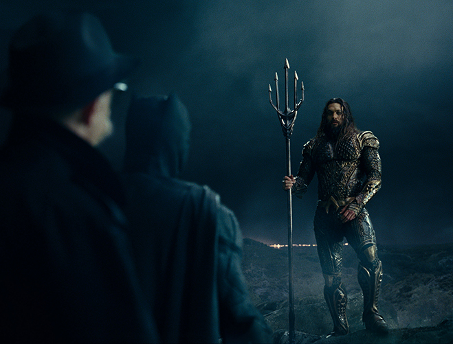 Aquaman (Jason Momoa) meets with Batman (Ben Affleck) and Commissioner Gordon (J.K. Simmons).
