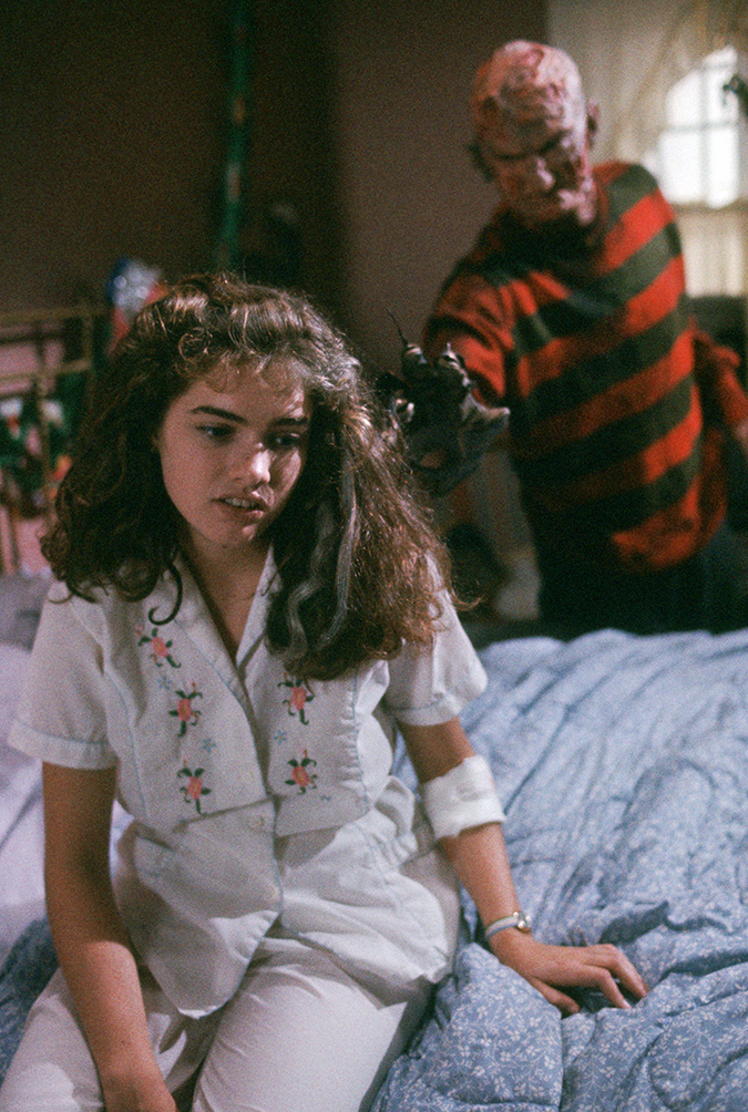 Heather Langengkamp as Nancy Thompson and Robert Englund as Freddy Krueger.