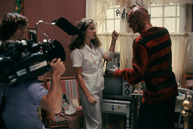 Behind the scenes look at Heather Langengkamp as Nancy Thompson and Robert Englund as Freddy Krueger blocking a scene.