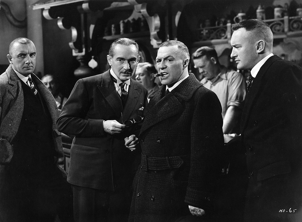 Confession of a Nazi Spy - Paul Lukas as Dr. Karl Kassel (second from left) and George Sanders as Franz Schlager (far right)