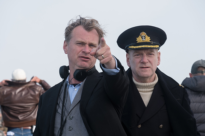Christopher Nolan and Kenneth Branagh having a discussion on the Dunkirk set.