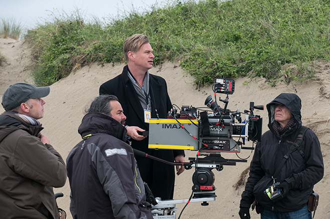 """director/writer/producer Christopher Nolan and his crew on the set of """"Dunkirk"""""""