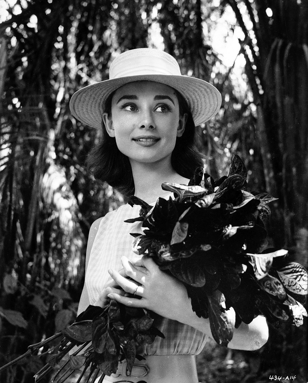The Nun's Story - Audrey Hepburn with flowers