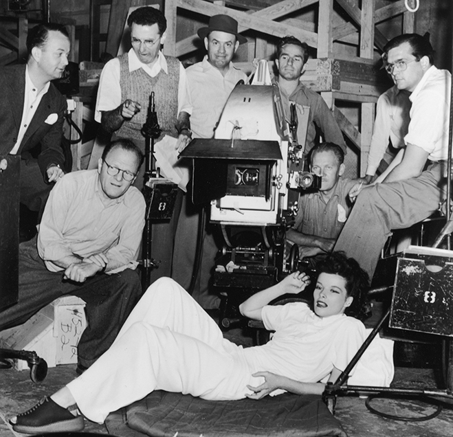 Katharine Hepburn hanging with the film's crew in this great behind-the-scenes photo. Director George Cukor is pictured standing second from the left.