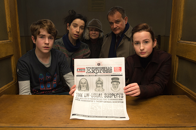 """SAMUEL JOSLIN as Jonathan Brown, SALLY HAWKINS as Mary Brown, JULIE WALTERS as Mrs. Bird, HUGH BONNEVILLE as Henry Brown and MADELEINE HARRIS as Judy Brown in the family adventure """"PADDINGTON 2,"""" from Warner Bros. Pictures and STUDIOCANAL, in association"""