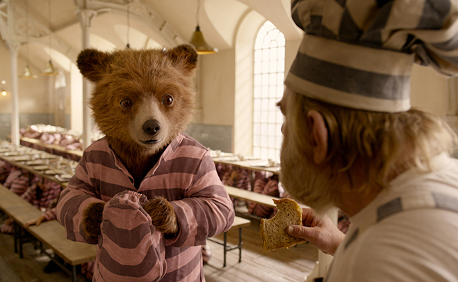 Paddington voiced by BEN WHISHAW and BRENDAN GLEESON as Knuckles McGinty