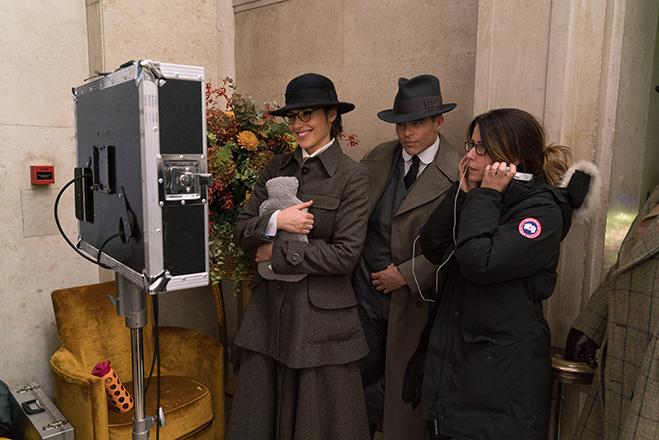 Gal Gadot, Chris Pine and director Patty Jenkins watch a scene on the set.