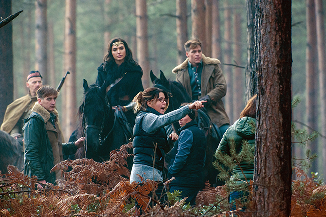 Ewen Bremner, Gal Gadot and Chris Pine listen to direction from Patty Jenkins.