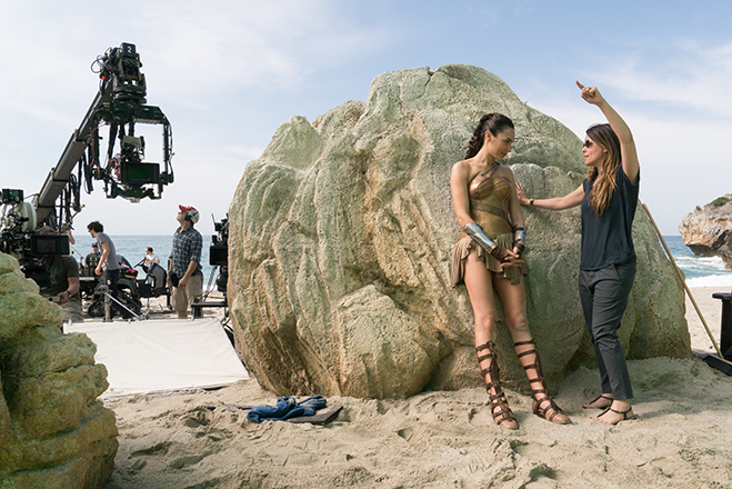 director Patty Jenkins and star Gal Gadot discussing a scene on the set of Wonder Woman