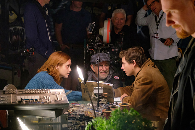OLIVIA COOKE, director/producer STEVEN SPIELBERG and TYE SHERIDAN on the set of Ready Player One.