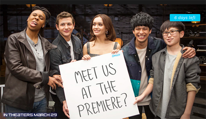 "Cast of Ready Player One holding ""Meet us at the premiere"" sign"