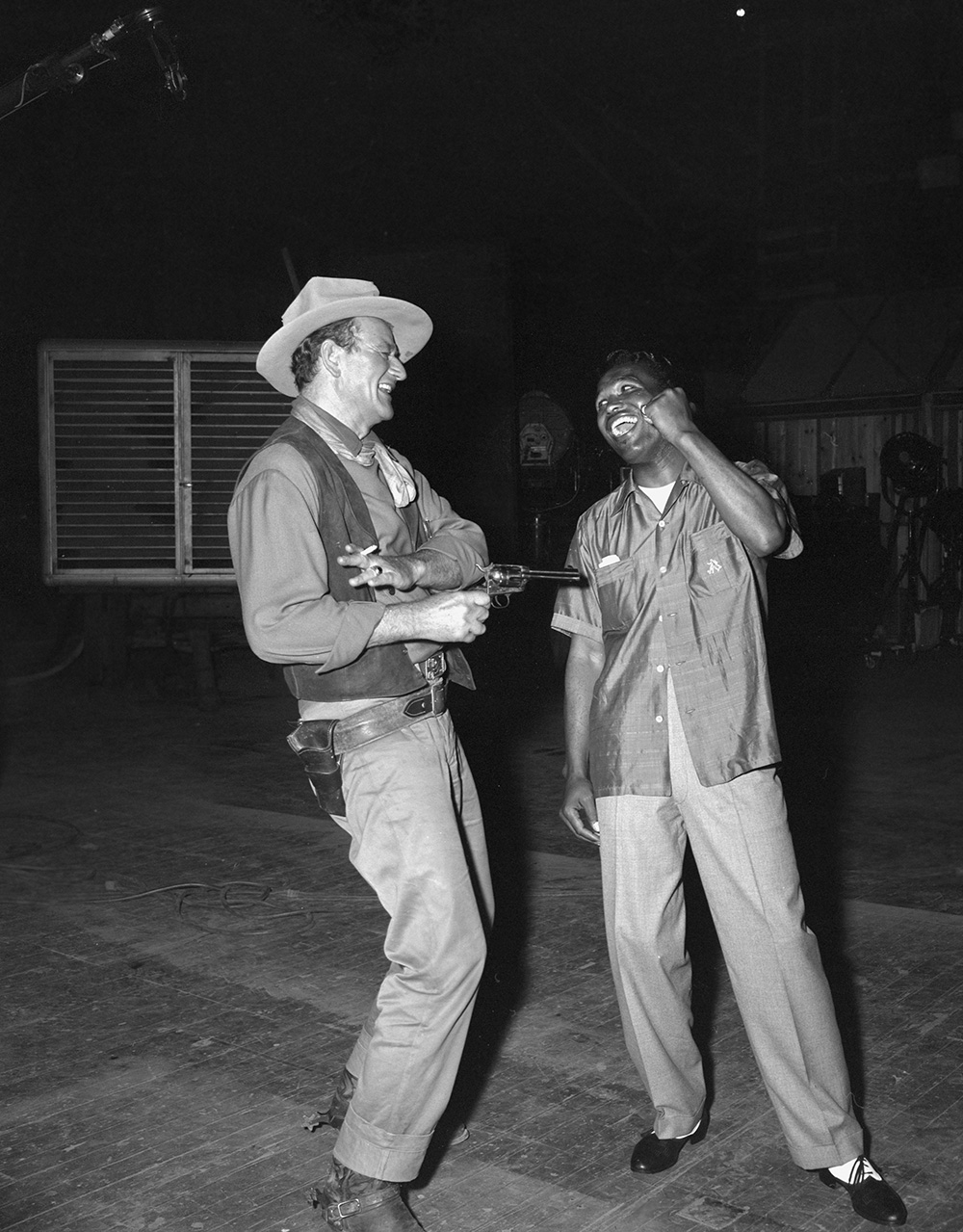 Rio Bravo John Wayne clowning with set visitor