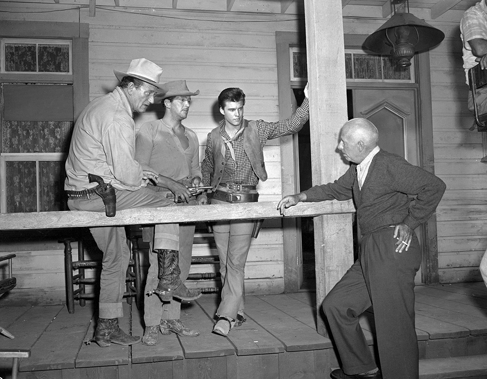 Rio Bravo Wayne, Martin, and Nelson consult with legendary director Howard Hawks