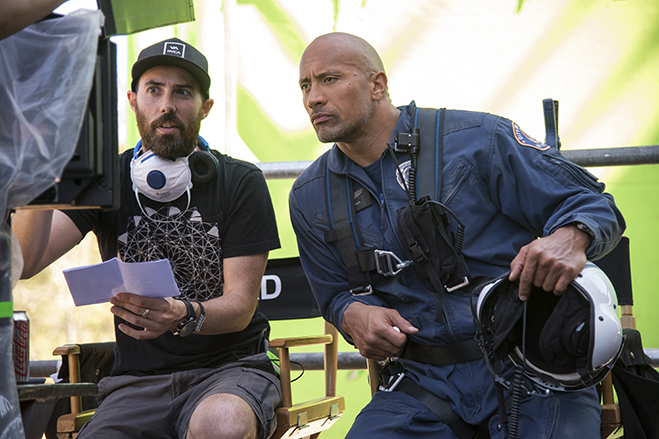 Director Brad Peyton and Dwayne Johnson discussing matters on the set of the blockbuster hit San Andreas. The two are currently filming Rampage in Atlanta, Georgia.
