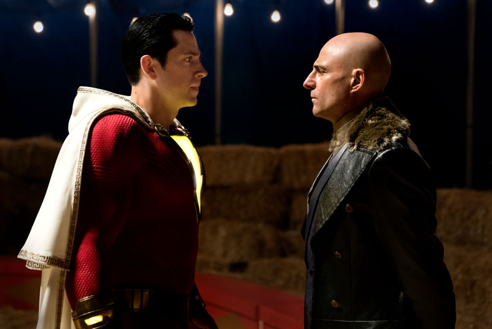 (L-r) MARK STRONG as Dr. Thaddeus Sivana and ZACHARY LEVI as Shazam