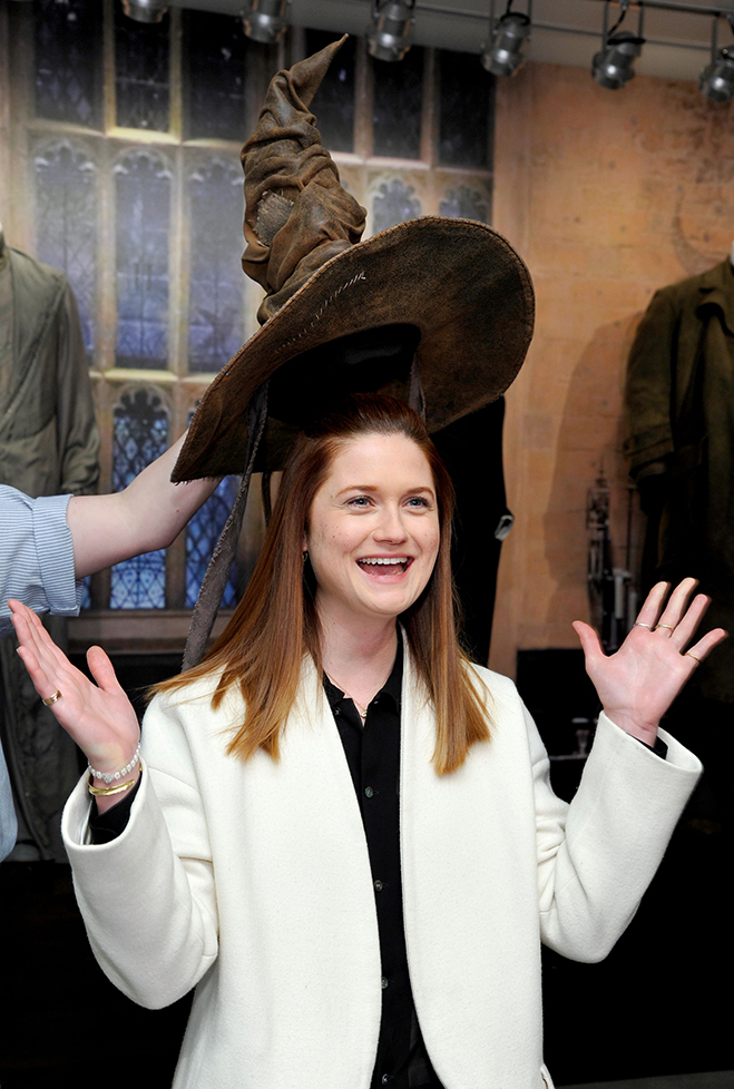 Bonnie Wright who played Ginny Weasley in the Harry Potter films gets sorted by the iconic Sorting Hat at the new studio exhibit.