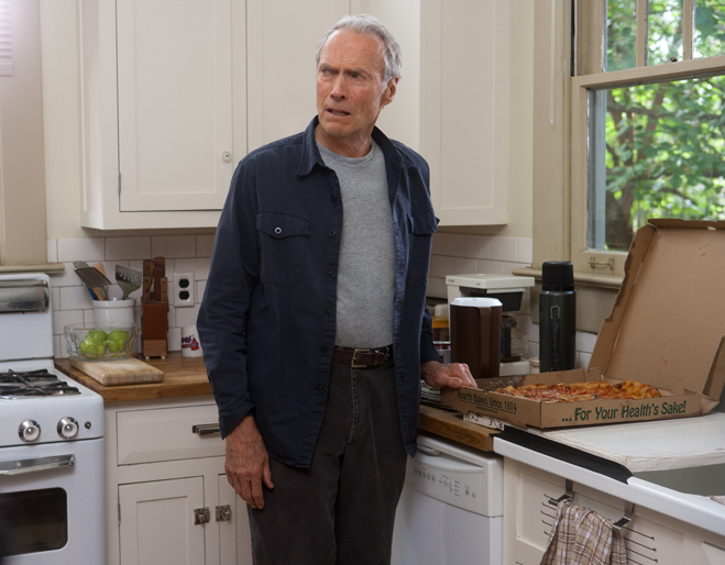 Clint Eastwood standing in kitchen with a box of pizza in Trouble with the Curve