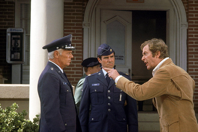 Michael Caine gets his point across to Richard Widmark in The Swarm