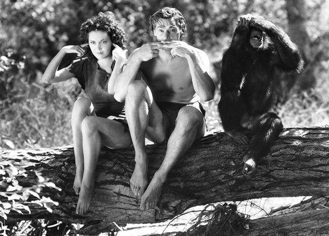 maureen o' sullivan as jane parker and johnny weissmuller as tarzan have fun on the set of Tarzan Escapes with cheetah the chimp