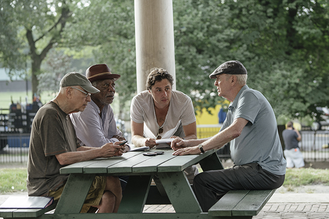 Alan Arkin, Morgan Freeman and Michael Caine discuss a scene with director Zach Braff