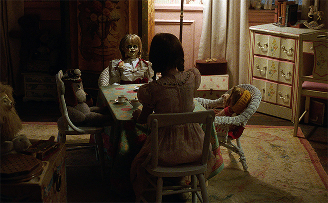 Annabelle sits for a tea party with Bee in Annabelle: Creation