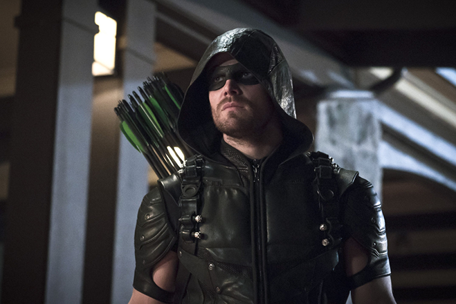 Stephen Amell as Arrow in costume