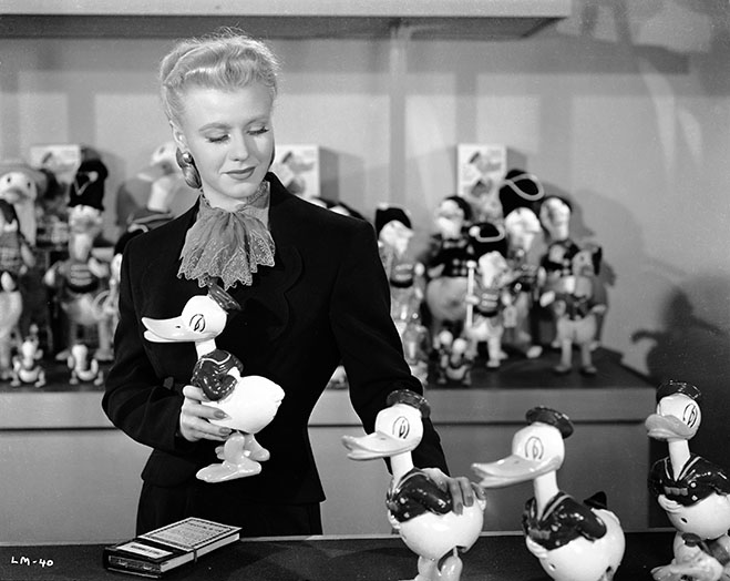Ginger Rogers holding a child's duck toy