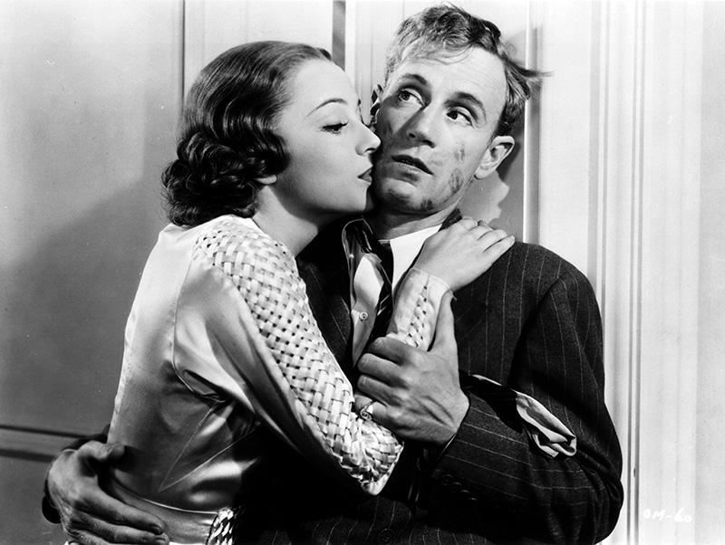 """Olivia de Havilland and Leslie Howard in """"It's Love I'm After"""" (1937)."""