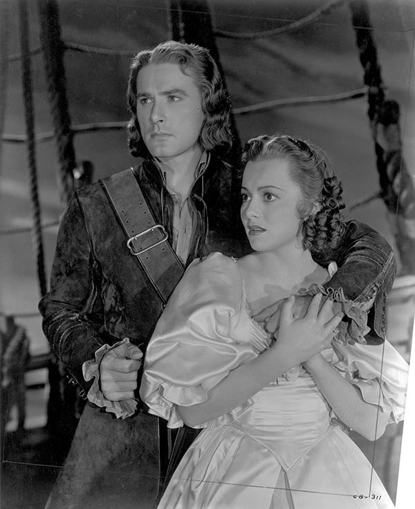 """Errol Flynn and Olivia de Havilland in """"Captain Blood."""""""