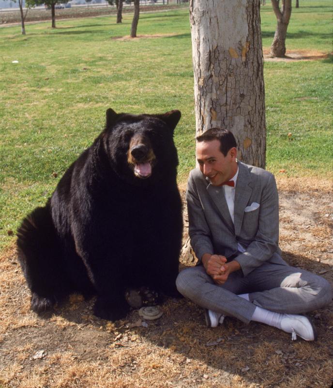 """Paul Reubens as Pee-Wee and bear friend in """"Pee-Wee's Big Adventure."""""""