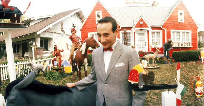 Pee Wee (Paul Reubens) in front of his magnificent home.