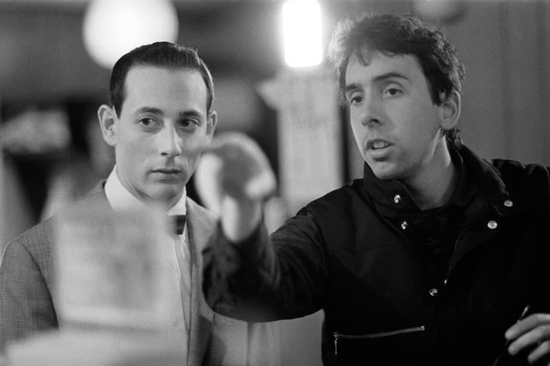 "Paul Reubens as Pee-Wee and director Tim Burton on the set of ""Pee Wee's Big Adventure."""