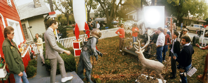Tim Burton and crew setting up a shot with Paul Reubens as many neighbors look on.