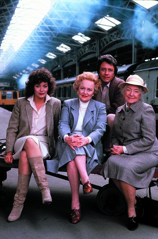 """Olivia de Havilland, Lesley-Anne Down, Bill Bixby, and Helen Hayes in """"Murder Is Easy."""""""