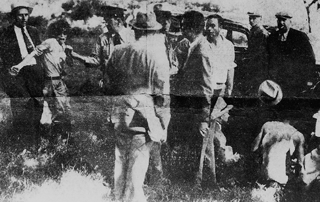 Blanche Barrow arrested on July 24, 1933 as her husband lie on the ground after having been shot. Buck would die five days later and Blanche would serve six years of a ten-year sentence.