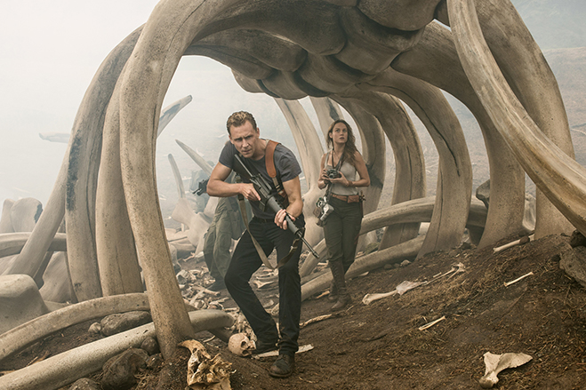 tom hiddleston and brie larson work their way through a skull island bone yard