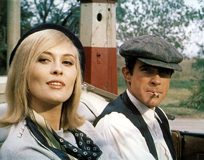 Faye Dunaway as Bonnie Parker and Warren Beatty as Clyde Barrow, wearing hat, match in mouth; both seated in car/convertible.