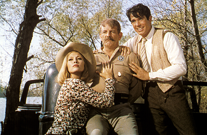 Faye Dunaway as Bonnie Parker, Denver Pyle as Texas Ranger Frank Hamer, and Warren Beatty as Clyde Barrow pictured in a scene that never occurred in real life.