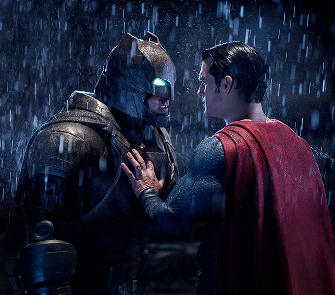 Ben Affleck as Batman, Henry Affleck as Superman in the rain