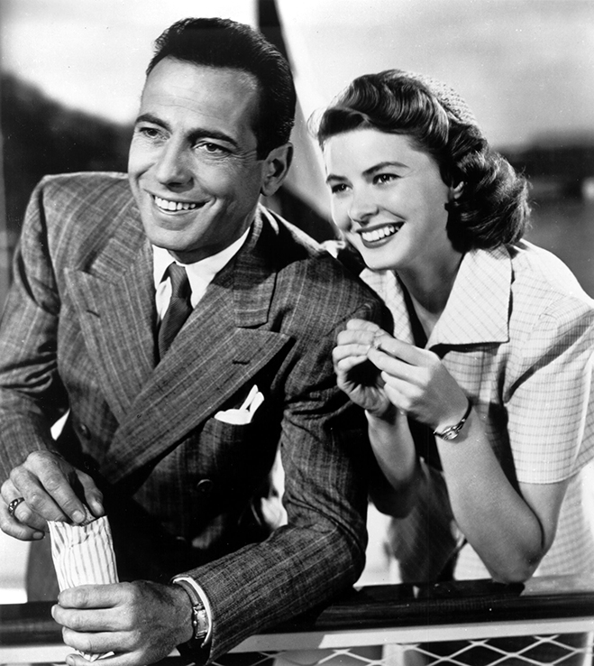 Humphrey Bogart and Ingrid Bergman smiling in a publicity photo