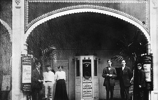 Full shot of the Warner Bros. first theater, the Cascade in New Castle, PA. Albert Warner, second from right.